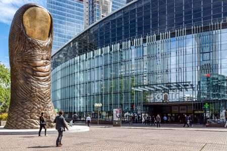 France, Paris - September 04 2019: The giant thumb sculpture and CNIT entrance in La Defense. 에디토리얼