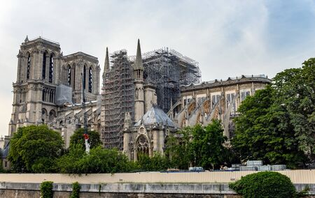 Paris, France: Notre Dame de Paris. Reinforcement work in progress after the fire. Wood Shoring now prevent the flying buttresses from collapsing.
