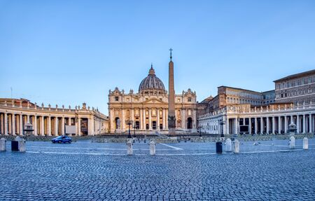 Police car patrol on St. Peter's Square in Vatican City at dawn - Rome, Italy.