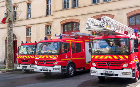 Paris, France - April 09 2020: Red fire trucks parked in front of the Headquarters of the Paris Fire Brigade in the 15th district, France