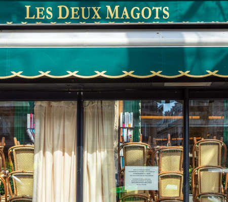 Paris, France - March 15 2020: Cafe les Deux Magots closed in order to stop the spread of Coronavirus epidemic.
