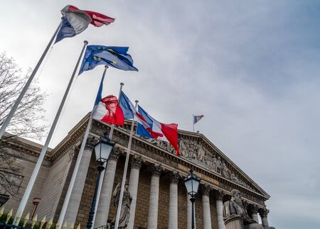 French and European Union flags in the wind in front of National Assembly in Paris - aka Assemblee nationale or Palais Bourbon Imagens