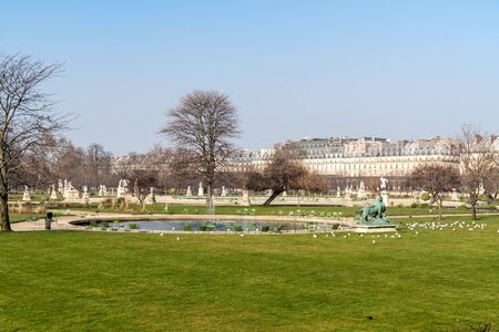 Jardin des Tuileries in Paris: View of a small pond in the empty garden in winter