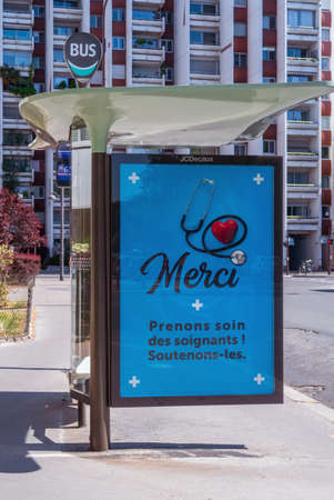 Paris, France - April 23 2020: Outdoor Bus stop billboard during Coronavirus Lockdown in Paris street with the message 'Thank you - Take care of the nursing staff ! Support them' Editorial