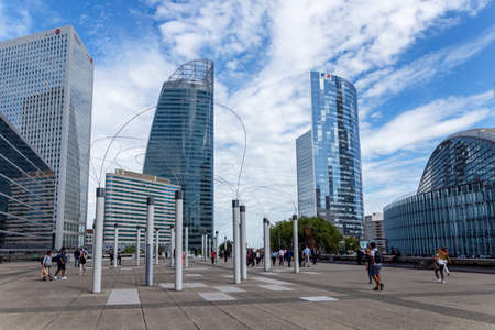 Paris, France - September 04, 2019: Cityscape of La Defense Business district near Paris with Utsurohi work of art in foreground Editorial
