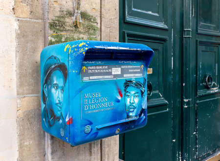 Paris, France - September 02 2019: La Poste mailbox with advertisement for the Musee de la legion d'honneur. Editorial