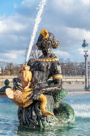 Close-up on one of the statue of the Maritime Fountain at the place de la Concorde - Paris, France