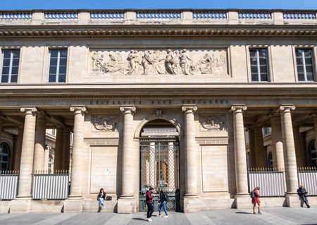 Paris, France - April 11, 2019: People passing along Rene Descartes medical university in Quartier Latin.