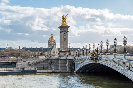 Dome des Invalides with Pont Alexandre III bridge in foreground - Paris, France