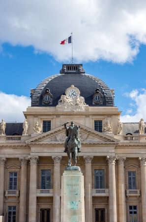 Paris, France - April 03, 2019: The Military School in Paris with statue of Marechal Joffre in foreground