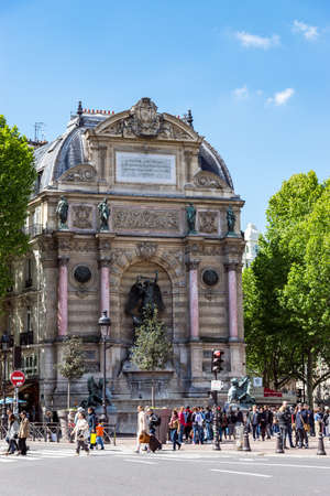 Paris, France - May 12, 2019: Fountain Saint-Michel at Place Saint-Michel in Paris, France. It was constructed in 1858-1860 during French Second Empire by architect Gabriel Davioud. Editorial