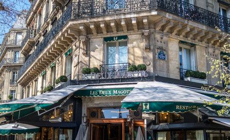 Paris, France - March 21 2019: Famous cafe Les Deux Magots located on Place Saint Germain des Pres. Editorial