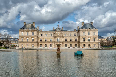 Paris, France - March 03 2020: French senate with octagonal basin in foreground in the Jardin du Luxembourg - Paris, France Editorial