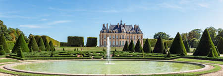Sceaux, France - August 30 2019: Panoramic view of Parc and chateau de Sceaux with a fountain in foreground - Hauts-de-Seine, France.