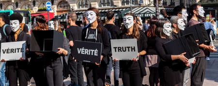 Paris, France - March 31, 2019: Anonymous for the Voiceless demonstration in Paris. AV holds an abolitionist stance against animal exploitation and promotes a vegan message Editorial