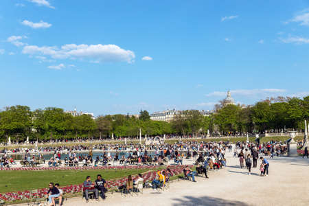 Paris, France - March 31, 2019: People enjoying sunshine in the Luxembourg garden on Sunday with The Pantheon in background