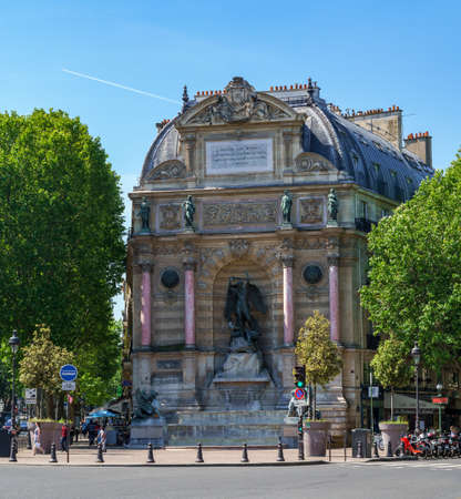 Paris, France - May 26 2020: Fountain Saint-Michel at Place Saint-Michel in Paris, France. It was constructed in 1858-1860 during French Second Empire by architect Gabriel Davioud. Editorial