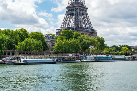 Paris, France - June 15 2020: Seine river Cruise boats waiting for the end of the Covid-19 Lockdown and return of tourists
