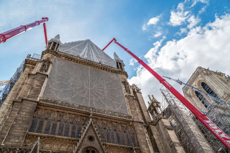 Paris, France - June 16 2020: Cranes begin to dismantle Notre Dame de Paris cathedral scaffolding, 14 months after the fire
