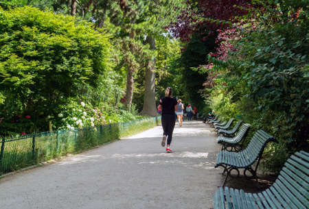 Paris, France - June 18 2020: Unidentified people are jogging in the Parc Monceau