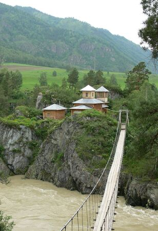 katun: The bridge on monastery over a river Katun. Mountain Altai.