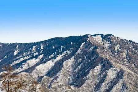 altay: Peak of mountain. Winter in Altay. Stock Photo