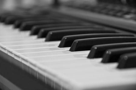 The keyboard of the electronic piano. Small depth of focus. photo