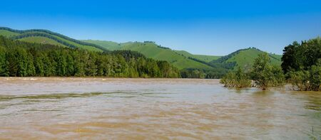 The river in mountains at the summer. A panorama. photo