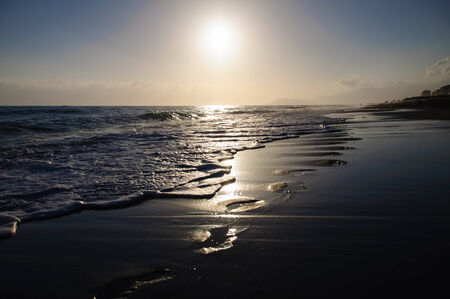 ray tracing: Traces on sand. Sea coast in the evening
