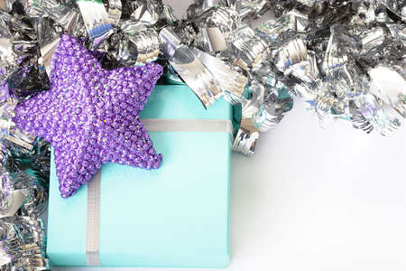 Purple star on top of a light blue gift box photo