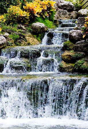 Waterfall stream over stones and growing plants Zdjęcie Seryjne