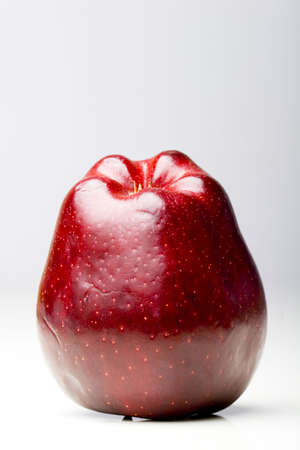 Glossy red delicious apple