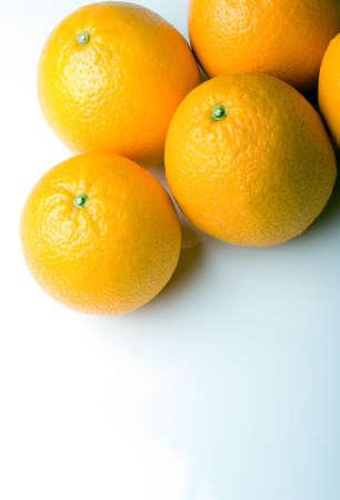 Fresh juicy oranges on a white background