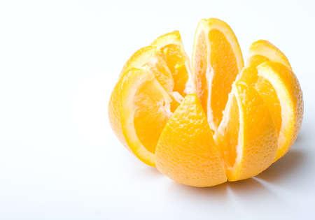 Fresh juicy ripe orange fruit cut to slices photo