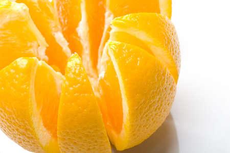 Fresh juicy delicious ripe isolated closeup orange fruit sliced