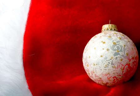 Decoration Christmas New Year silver ornament ball on a red and white background Zdjęcie Seryjne
