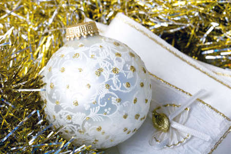 Decoration Christmas New Year silver ornament ball on a shiny golden background with fabric napkin close up Zdjęcie Seryjne
