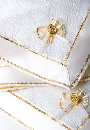 Beautiful white creamy textured fabric napkins with ribbon and bow for table decoration