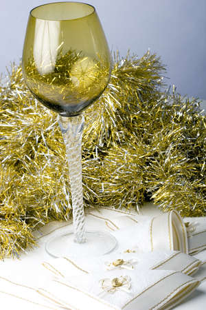 Luxurious expensive tall wine glass on a beautiful Christmas New Year theme decorated table