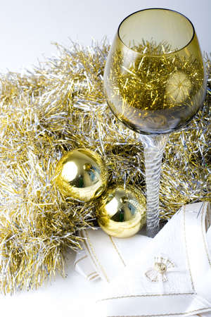 Luxurious expensive tall wine glass on a beautiful Christmas New Year theme decorated table with golden color ornament balls Zdjęcie Seryjne