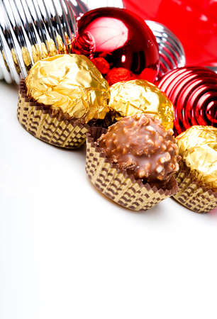 Chocolate candy treats with Christmas New Year holiday theme ornaments background