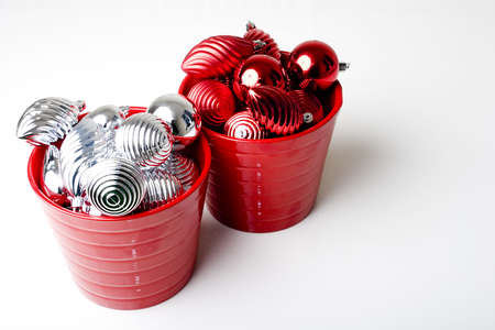 Bunch Christmas New Year red and silver decoration ornaments in two red baskets