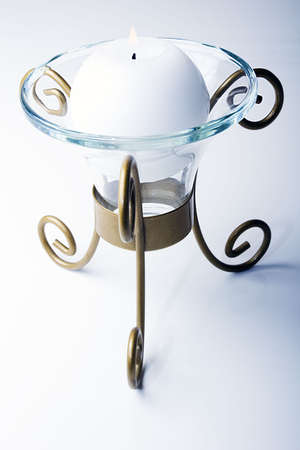 White color sphere shaped candle in a luxurious glass and metal holder Zdjęcie Seryjne