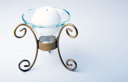 candle holder: White color sphere shaped candle in a luxurious glass and metal holder Stock Photo