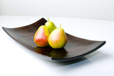 Beautiful delicious fresh pears in a modern style wooden vase Zdjęcie Seryjne