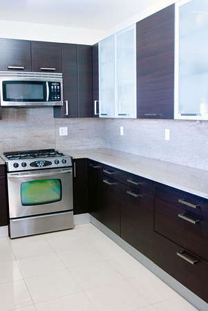 stove: Modern contemporary style kitchen with granite top