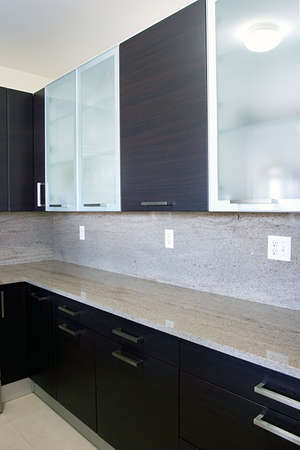 kitchen cabinets: Modern contemporary style wood and glass kitchen cabinets