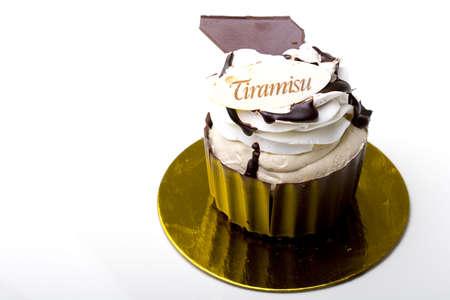 Pastry Tiramisu layered cake in a chocolate cup isolated Zdjęcie Seryjne