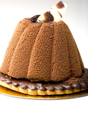 Pastry chocolate mousee cake on top of a glazed cookie dessert