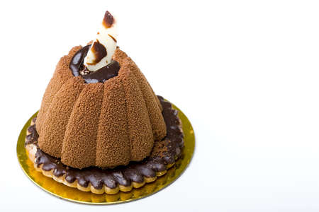 Pastry delicious chocolate mousse cake on top of a glazed cookie dessert isolated
